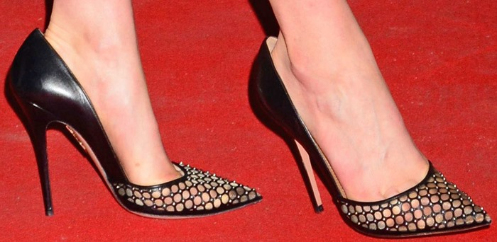 Taylor Schilling shows off her feet in studded mesh pumps