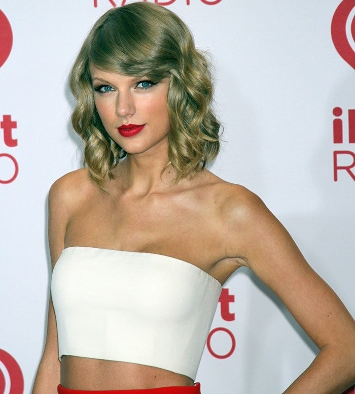 Taylor Swift wearing a Calvin Klein Collection white bandeau top