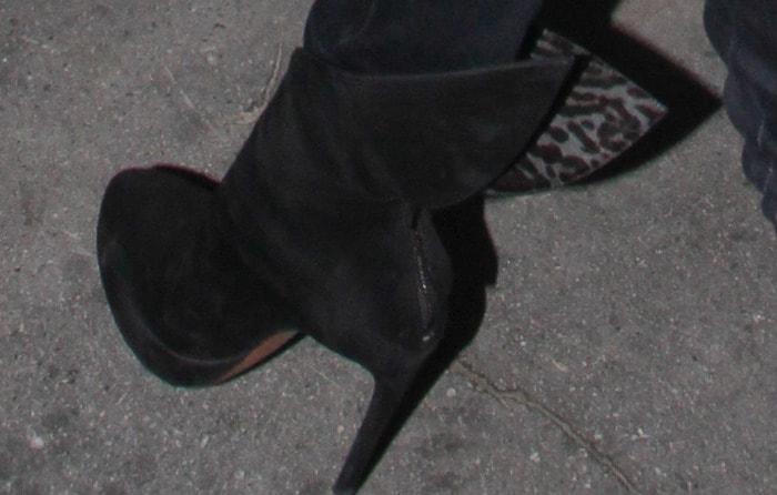 Victoria Beckham wearingblack Azzedine Alaïa ankle boots