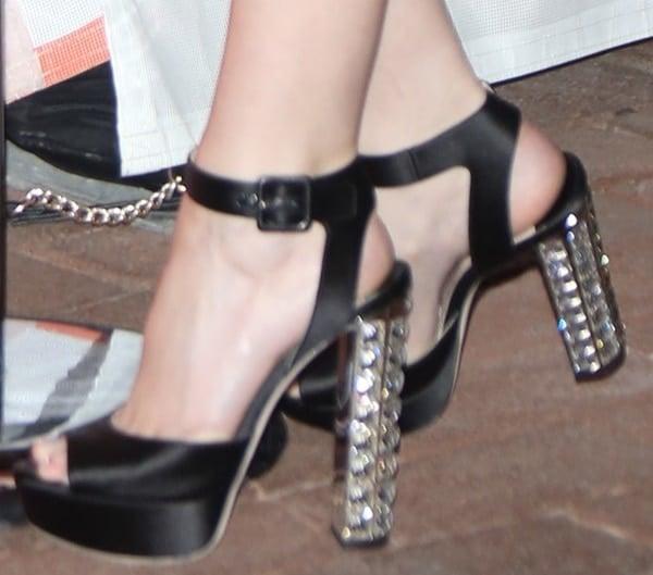 Anna Kendrick wearingplatform sandals with crystal-covered heels