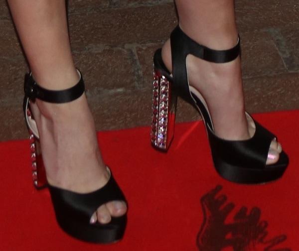 Anna Kendrick rocking black suede Miu Miu sandals