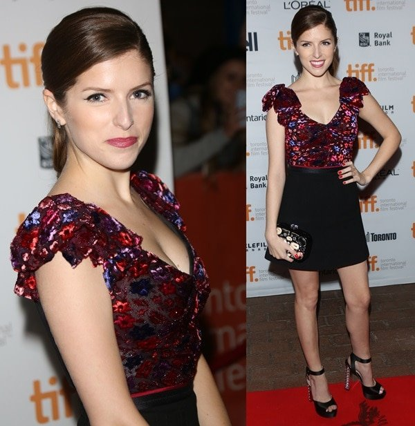 Anna Kendrick ina velvet printed top, a high-waisted skirt, and platform sandals with crystal-covered heels