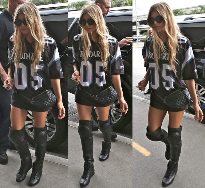 Fergie in a skimpy outfit pairedwith thigh-high sneakers and a quilted fanny pack