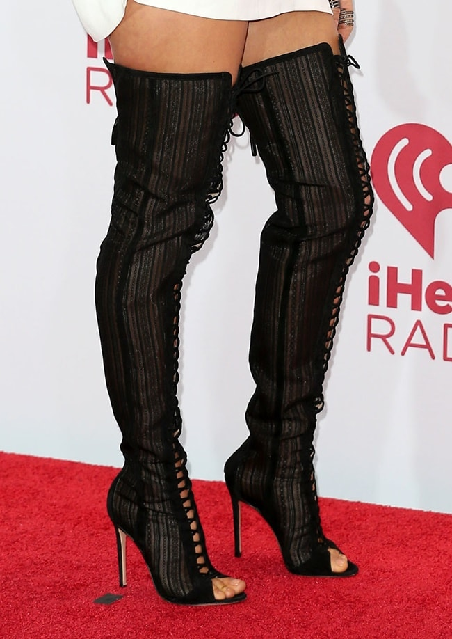 Fergie's sexy lace-up thigh-high boots