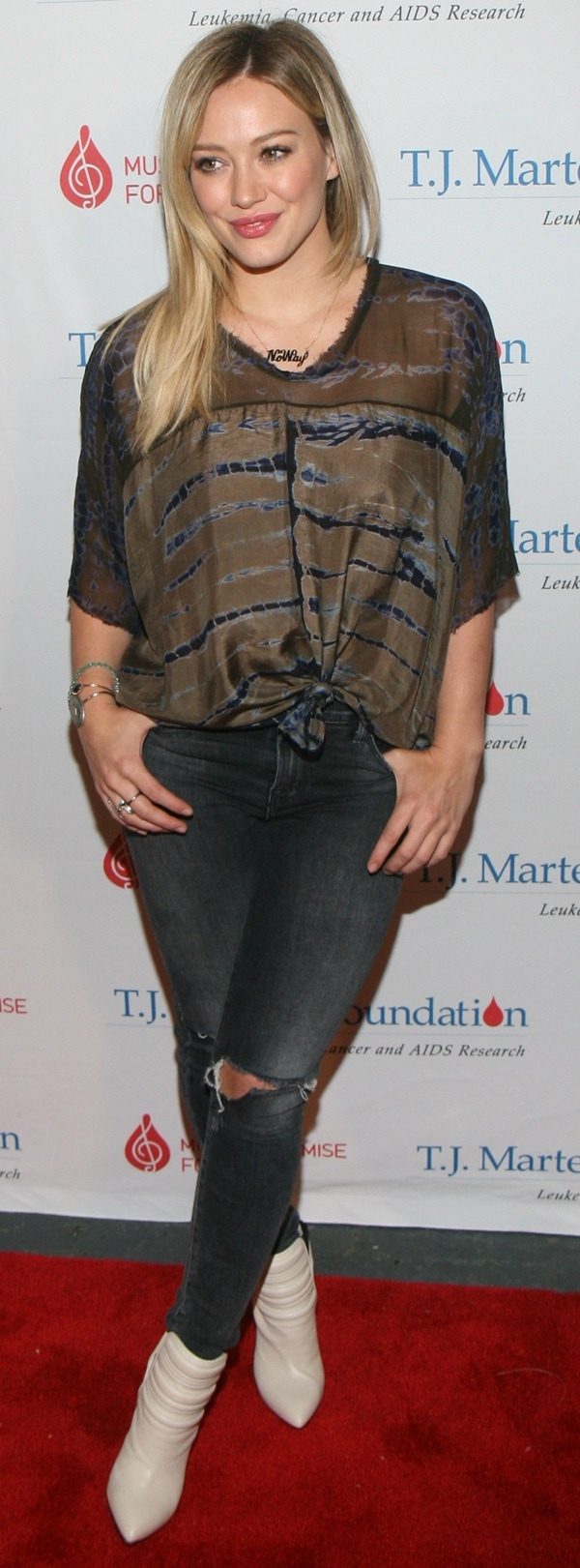 Hilary Duff sporting anoversized Raquel Allegra top, which she knotted in the front, and ripped skinny jeans