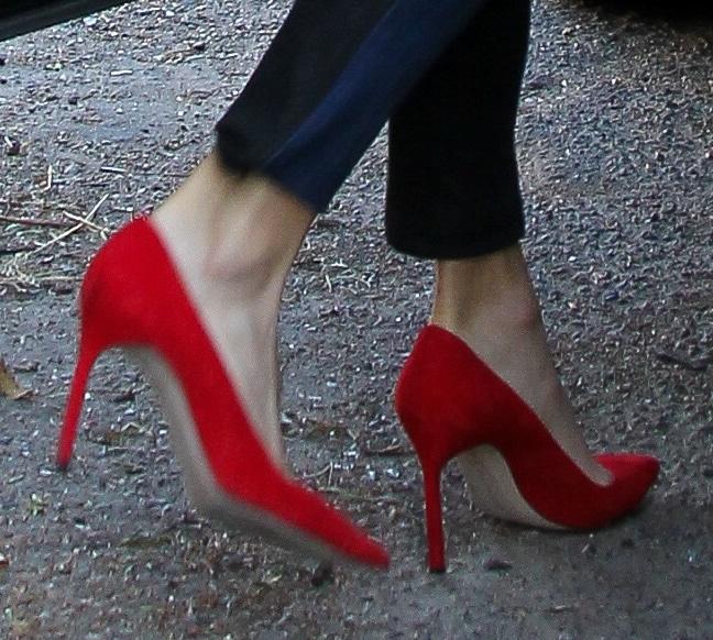 Nikki Reed wearingred hot stilettos