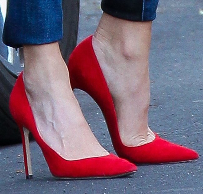 Nikki Reed shows off her feet in red pointy pumps