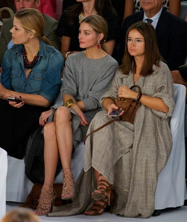 (L-R) Mary Alice Stephenson, Olivia Palermo, and Miroslava Duma attend the Carolina Herrera fashion show