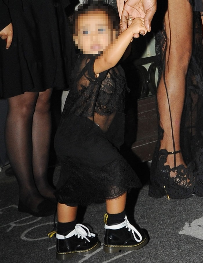 Kim Kardashiandrew criticisms for dressing up her 15-month-old daughter in a similar see-through outfit
