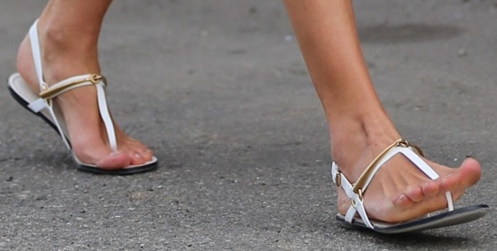 Alessandra Ambrosio shows off her sexy feet in white sandals