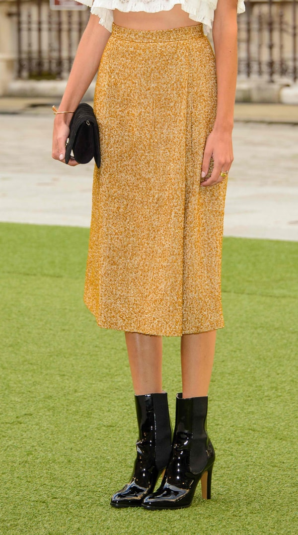 Alexa-Chung donned a lovely white tiered cropped top and a mustard midi skirt