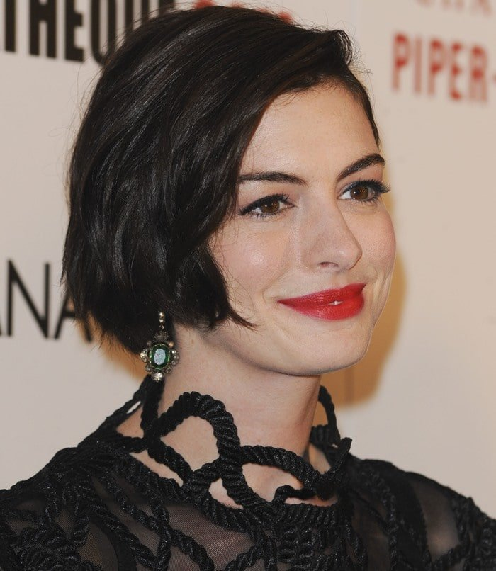 Anne Hathaway donned a stunning black rope-lace dress from the Christopher Kane Spring 2015 collection featuring long sleeves
