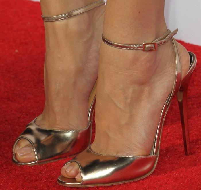 "Aubrey Plaza wearingmirrored gold leather ""Jane"" sandals from Jimmy Choo"