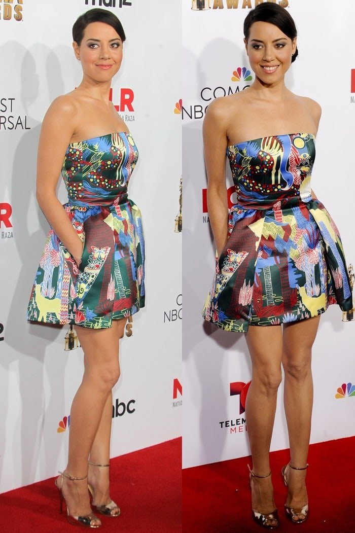 Aubrey Plaza ina strapless dress from the Mary Katrantzou Resort 2015 collection featuring the label's signature high-impact eclectic prints