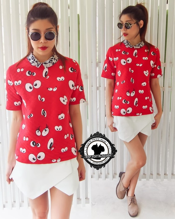 Ramida wears a red cartoon-print top