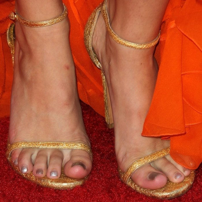 Bella Thorne's sexy feet in gold foil ankle-strap Stuart Weitzman Nudist sandals