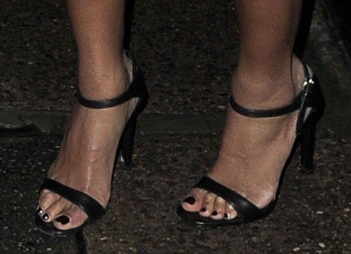 Beyonce completed her ensemble with a pair of simple leather sandals by Prada