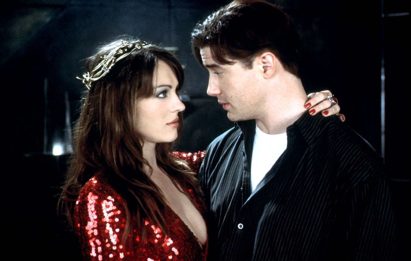"""Brendan Fraser as Elliot Richards / Jefe / """"Mary"""" / Abraham Lincoln and Elizabeth Hurley as The Devil in the 2000 American comedy film Bedazzled"""