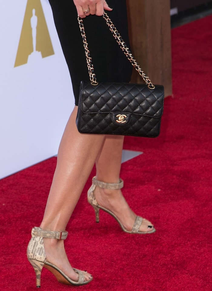 "Cameron Diaz styled her dress with zipper-trimmed ""Tejus"" sandals by Givenchy"