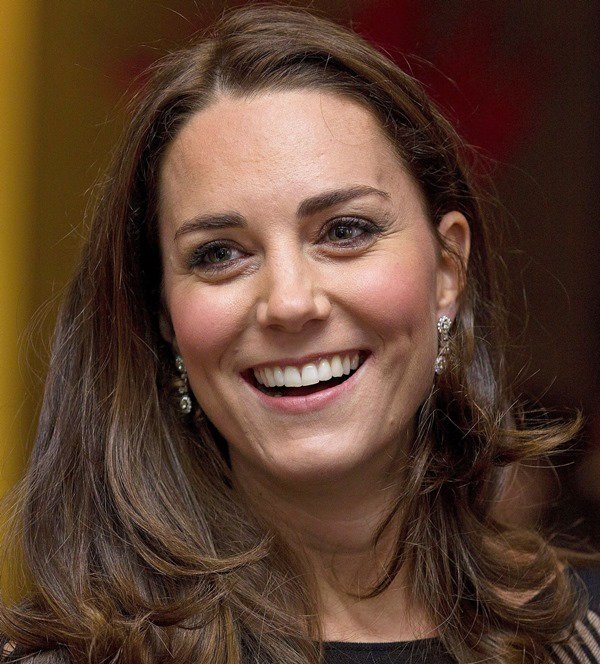 Catherine, Duchess of Cambridge, shows off herdiamond earrings and a dazzling smile