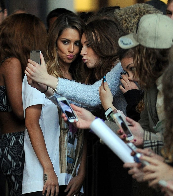 Cheryl Fernandez-Versini posing with fans outside the BBC Radio 1 studios in London, England, on October 7, 2014