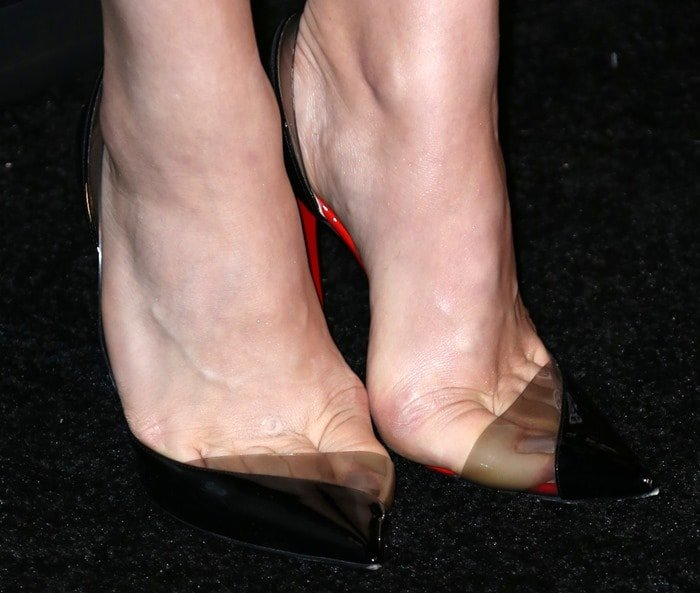 Chloë Grace Moretz showing off her feet in black patent leather Christian Louboutin Miss Rigidaine pumps
