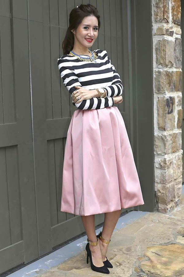 Christina in a striped top witha sweet midi skirt