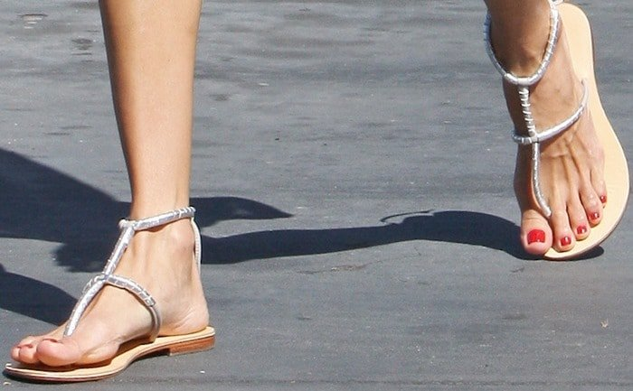 Alessandra Ambrosio showing off her feet in thong gladiator Milano sandals by Cocobelle
