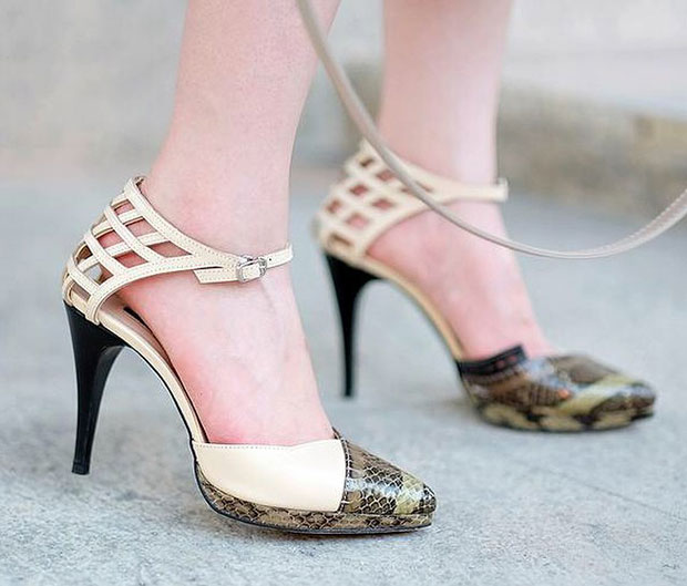 Dorothy's pumps feature caged heel counters and snakeskin vamps