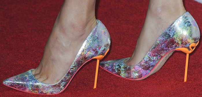 """Elizabeth Banks rockingpointy-toe silver patent leather """"Coco"""" pumps by Sophia Webster featuring a metallic rainbow print"""