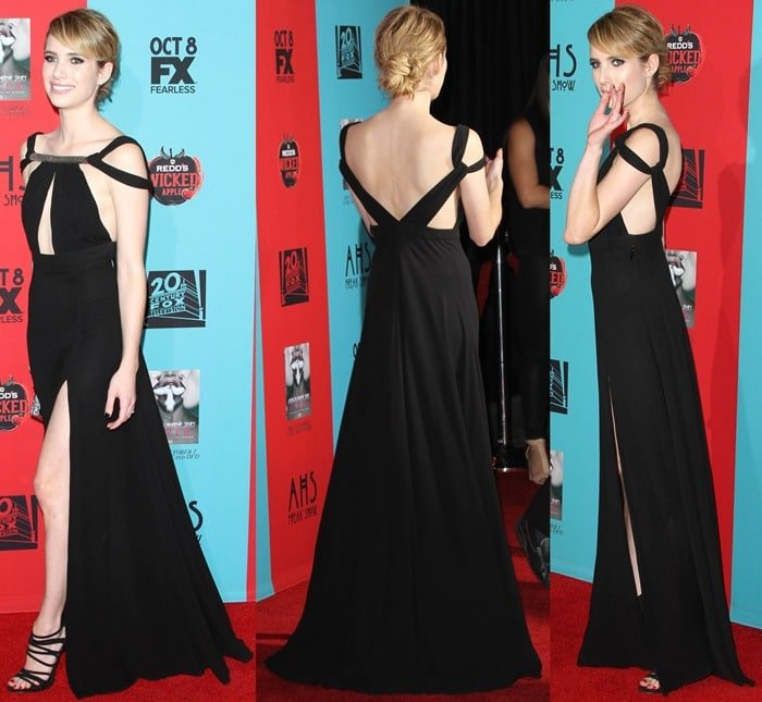 Emma Roberts flaunts her legs in a black gown featuring cutout details, a thigh-high slit, and an embellished neckline