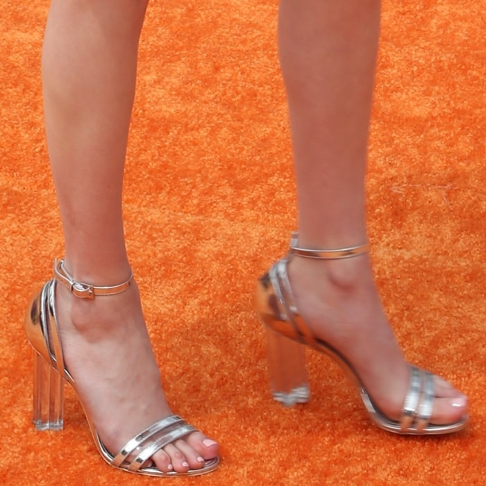 Emma Roberts showed off her feet in silver metallic sandals