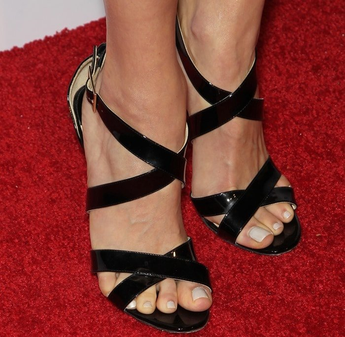 """Emmy Rossum shows off her sexy feet in""""Lottie"""" leather crisscross sandals by Jimmy Choo"""