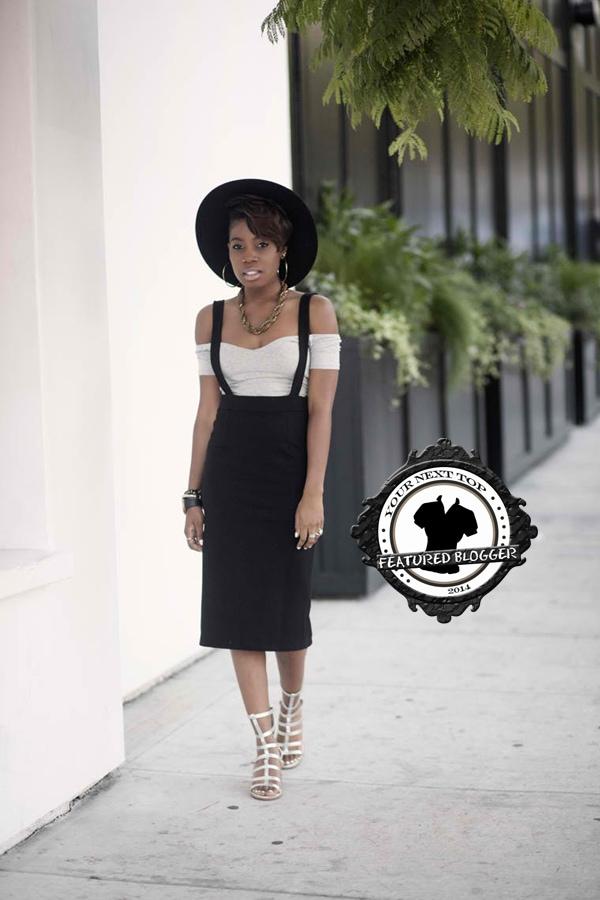 Enocha teams a suspender pencil skirt with an off-shoulder top