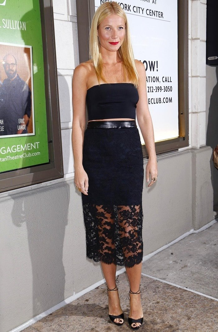 Gwyneth Paltrow donned a two-piece outfit from the Monique Lhuillier Fall 2014 collection consisting of a lace-overlay pencil skirt and a black bandeau