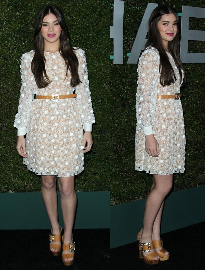 Hailee Steinfeld wore a lace dress from the the Michael Kors Resort 2015 collection and tan accessories from the Kors collection