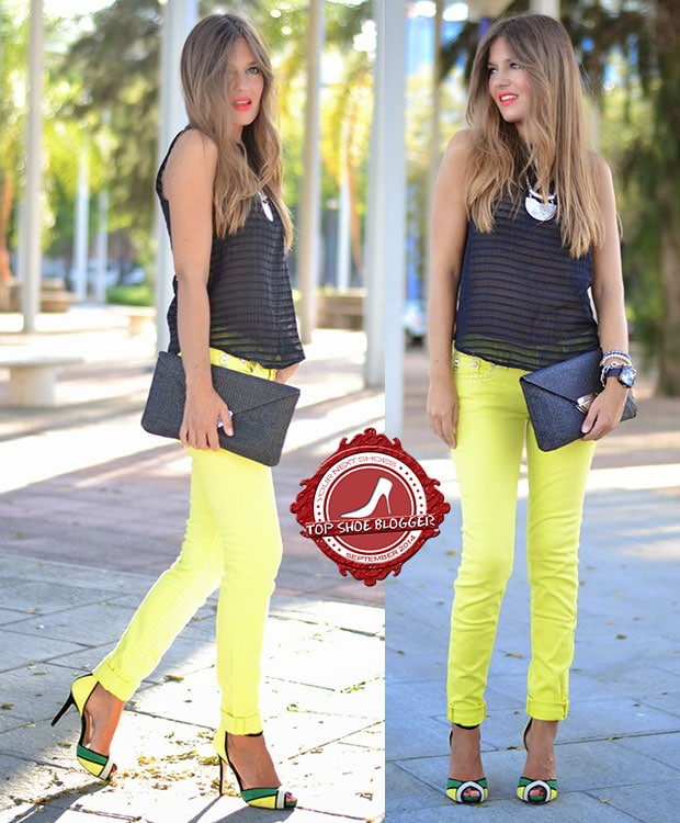 Helena wearsyellow pants with matching bright heels