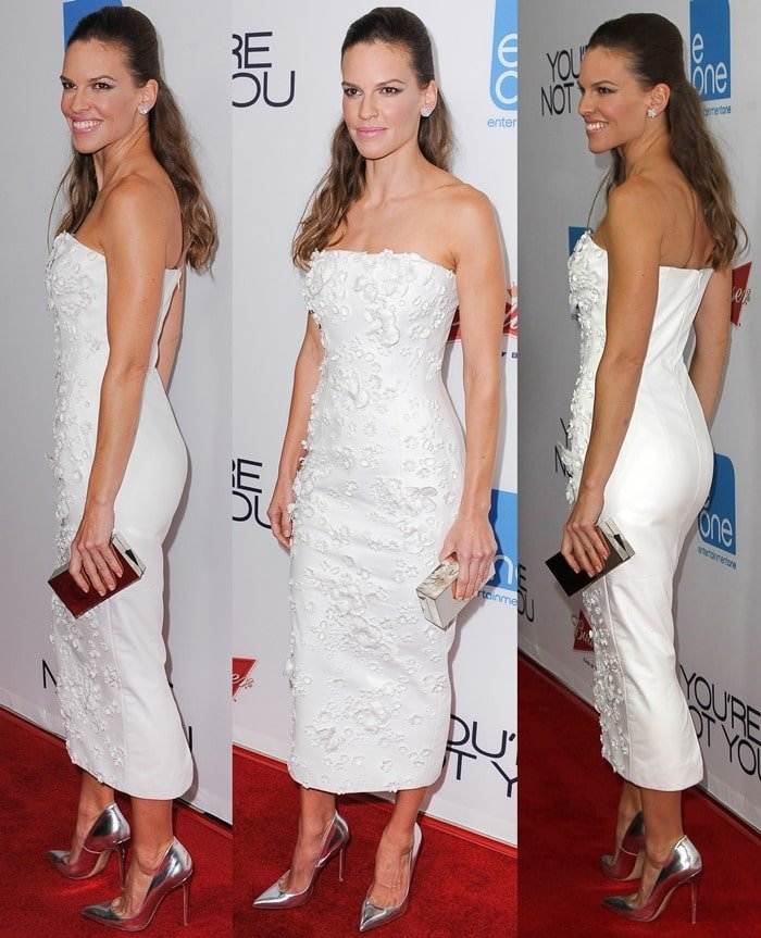 Hilary Swank flashed her legs in a white floral cocktail dress
