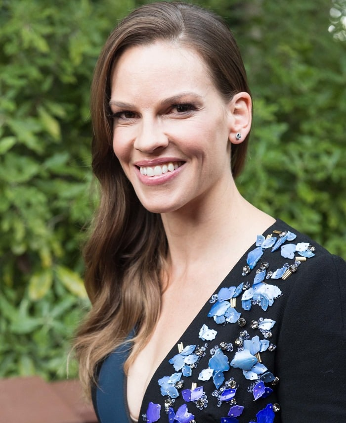 Hilary Swank styled the embellished metallic panel dress with Melissa Kaye Jewelry earrings, a Graziela Gems ring, and black suede pointy-toe 'Blade' pumps