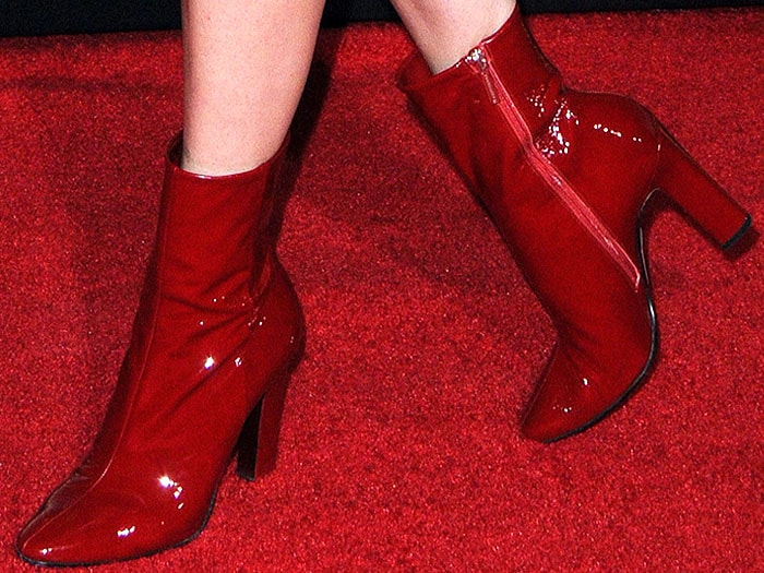 Closeups of Jena Malone's shiny red patent boots
