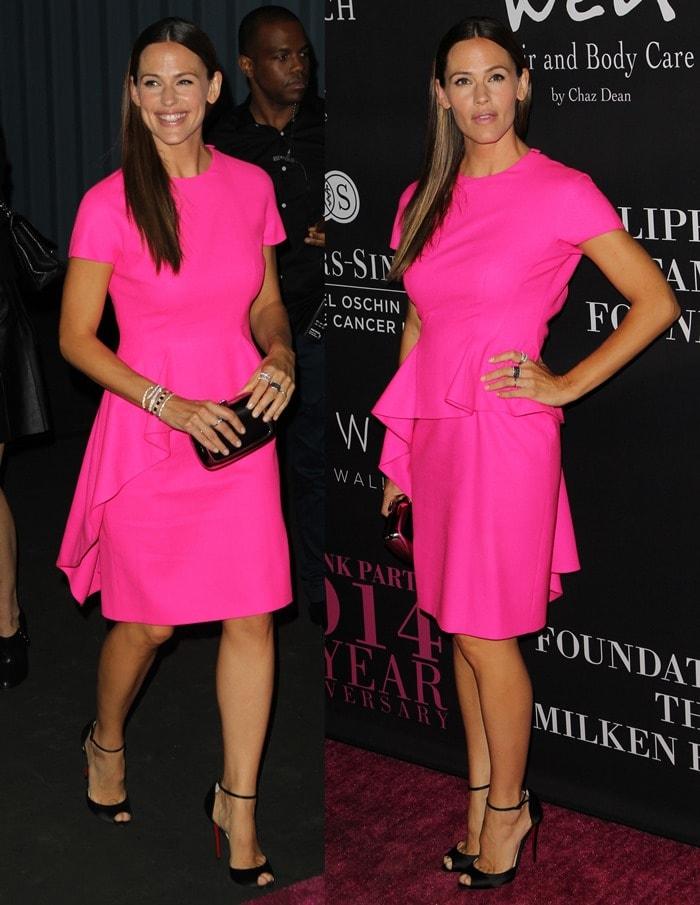 Jennifer Garner donned a bright-pink Dior dress featuring ruffled peplum detailing and a demure knee-length hemline