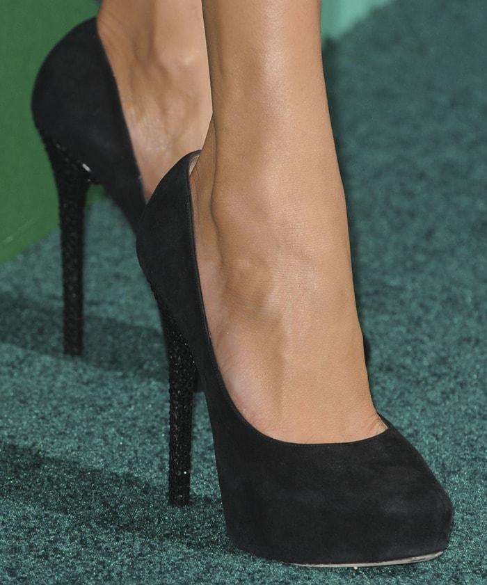 "Jennifer Lopez showing off her feet inbejeweled ""Esam"" pumps by Jimmy Choo"