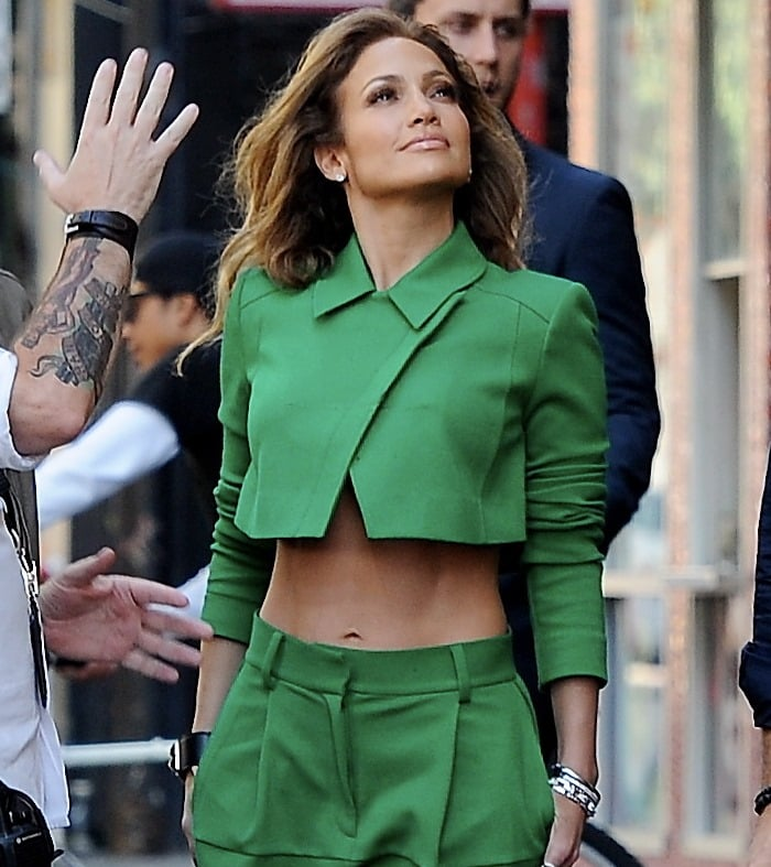 Jennifer Lopez in loose-fitting wool crepe pants and a cropped moto jacket