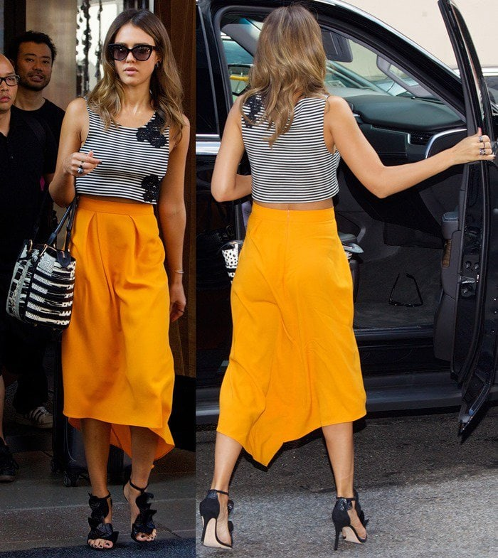 Jessica Alba in Manhattan to promote her new film, 'Sin City: A Dame to Kill For', is carrying a Christian Louboutin handbag as she departs her SoHo hotel in New York on August 5, 2014