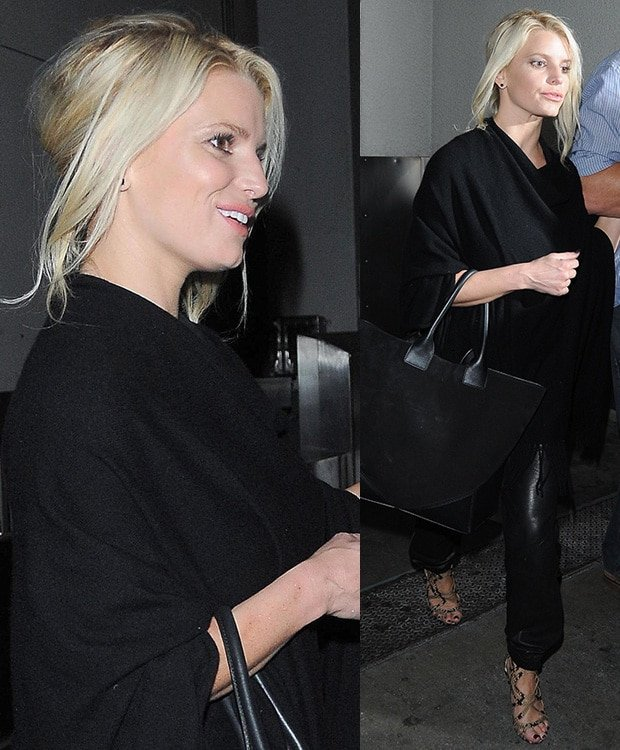Jessica Simpson kept it low key in a black top with a fringed scarf and a pair of loose-fitted leather trousers