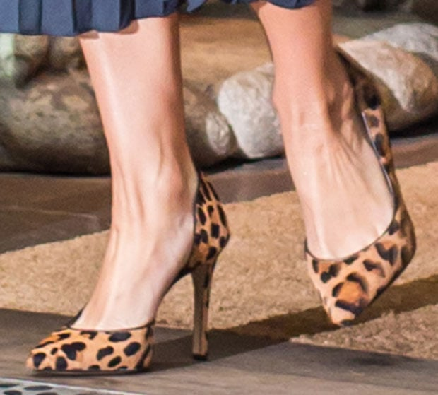 Jessica Simpson wearing leopard d'Orsay Claudette pumps from her eponymous shoe brand