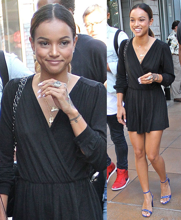 Opting for a flirty leggy look, Karrueche wore a low-cut long-sleeved mini dress and styled it with a few gold necklaces and a pair of blue stilettos.