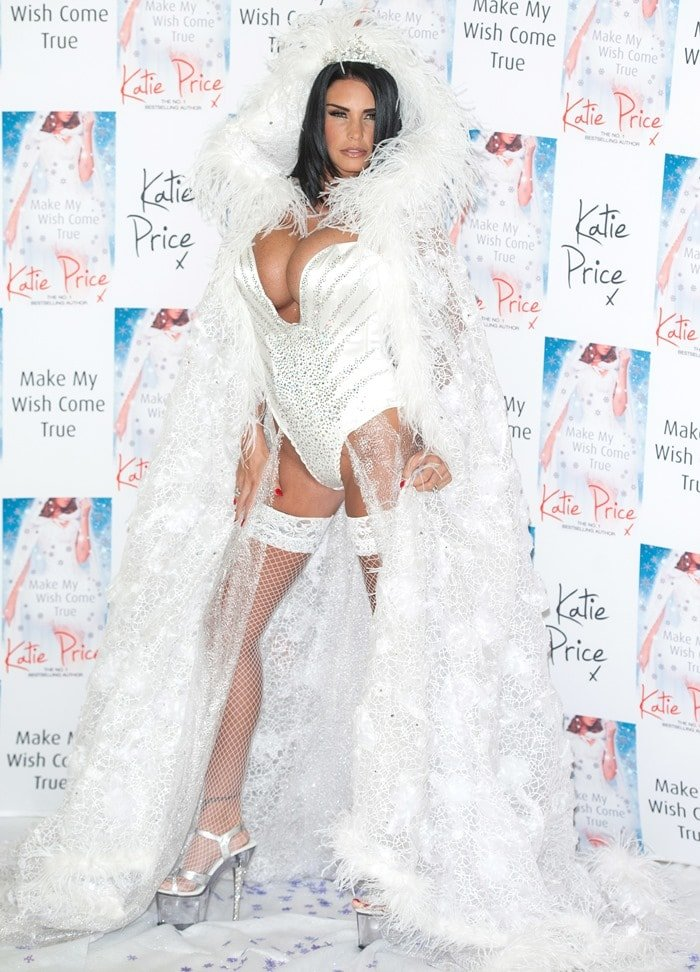 Katie Price in a crazy fairy costume, fishnet stockings, and stripper heels