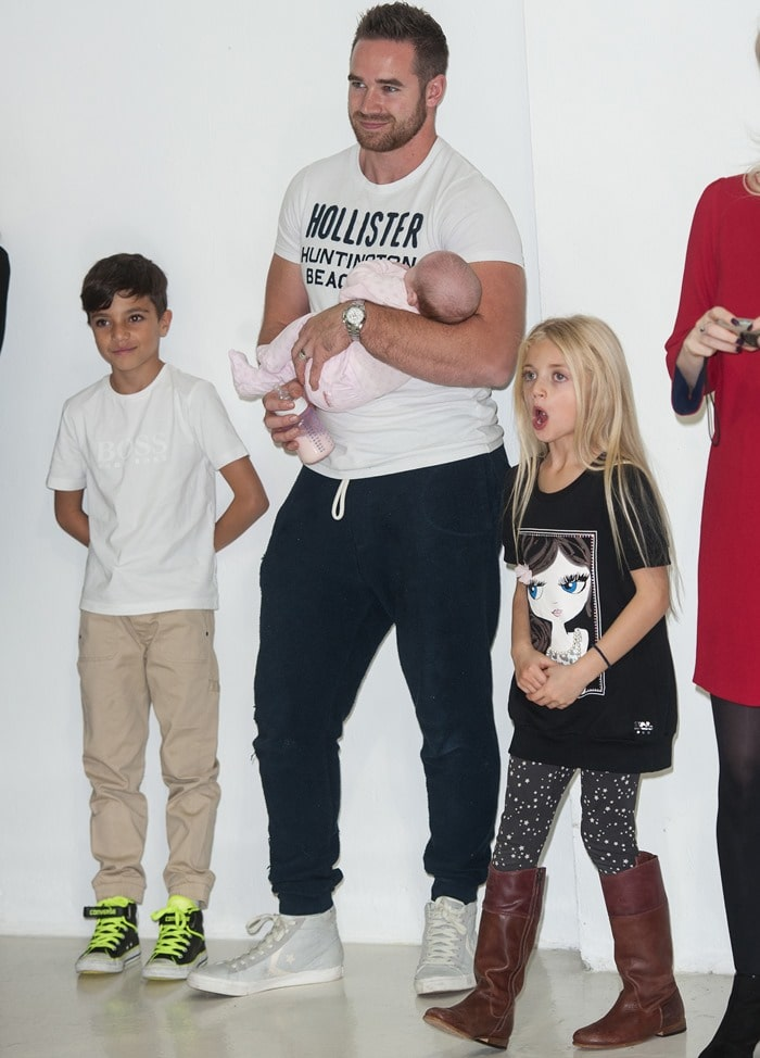 Katie Price's husband Kieran Hayler, Junior, Jett, and Princess Tiaamii, at the launch of her new book, Make My Wish Come True, at Worx in London, England, on October 22, 2014