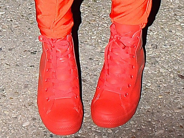 Katy Perry wearing Chuck Taylor All Stars waterproof rubber rain sneakers